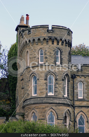 Historical house with turret stock photo, Exterior of historical house with turret, blue sky background. by Martin Crowdy