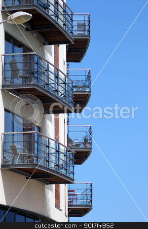 Holiday apartments stock photo, Holiday apartments in tower block with blue sky background. by Martin Crowdy