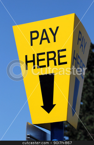 Pay here sign stock photo, Yellow car parking pay here sign with blue sky background and directional arrow. by Martin Crowdy