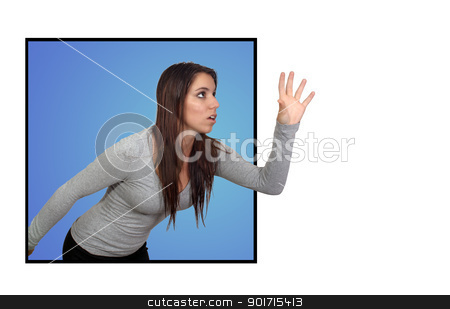 Attractive Brunette Reaching or Grabbing (2) stock photo, An attractive brunette reaching beyond a frame for a 3-D effect.  Isolated on a white background with generous copyspace. by Carl Stewart