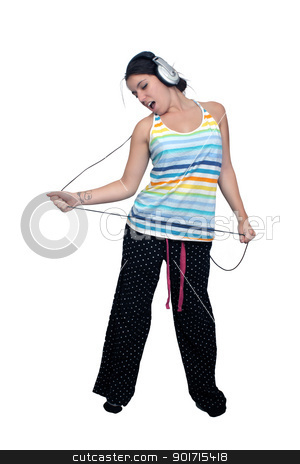 Attractive Brunette with Headphones (1) stock photo, An attractive brunette sings along with music in her headphones, dressed in pajamas or sleepwear.  Isolated on a white background with generous copyspace. by Carl Stewart