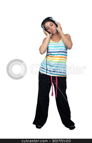 Attractive Brunette with Headphones (3) stock photo, An attractive brunette listens to music in her headphones, dressed in pajamas or sleepwear.  Isolated on a white background with generous copyspace. by Carl Stewart