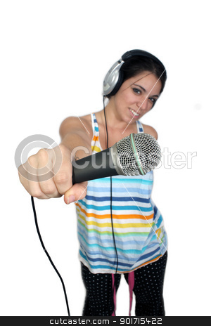 Attractive Brunette with Headphones and a Microphone (2) stock photo, An attractive brunette holds a microphone out to the camera, dressed in pajamas or sleepwear.    Selective focus on the microphone.  Isolated on a white background with generous copyspace. by Carl Stewart