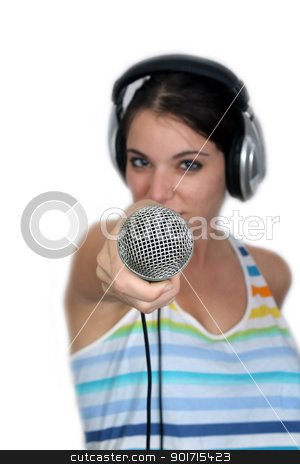 Attractive Brunette with Headphones and a Microphone (3) stock photo, An attractive brunette holds a microphone out to the camera, dressed in pajamas or sleepwear.  Selective focus on the microphone.  Isolated on a white background with generous copyspace. by Carl Stewart