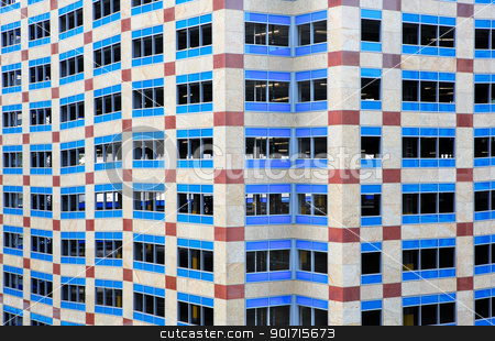 Angular Blue window building stock photo, Burgandy, blue, and white elevated parking lot building with lots of odd angles by bobkeenan