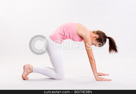 Flexible young yoga girl. stock photo, Portrait of a flexible young yoga girl in pink top. by exvivo