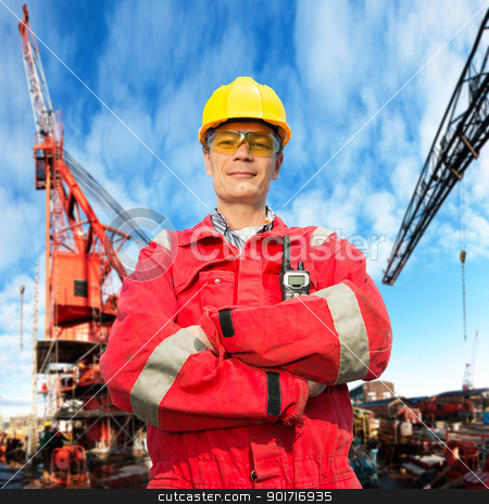 Offshore engineer stock photo, Offshore engineer, looking proudly, standing on the deck of an industrial vessel at the docks by Corepics VOF