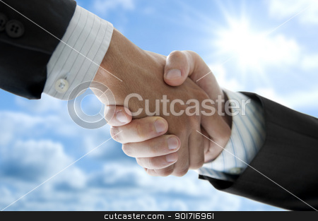 Hands shaking stock photo, Businessmen shaking hands over blue sky, low angle view. by szefei