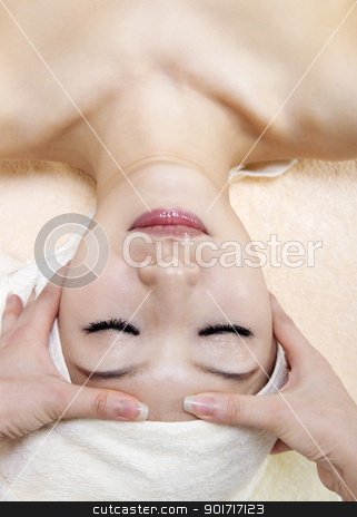 Head Massage stock photo, Beauty and Spa - Asian Girl having a massage on her head by szefei