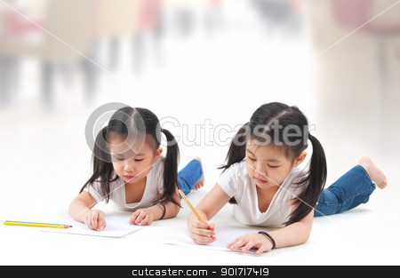 Drawing stock photo, Little Asian girls drawing, lying on floor by szefei
