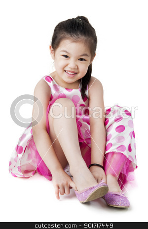 All by myself stock photo, Little girl putting on her shoe by szefei
