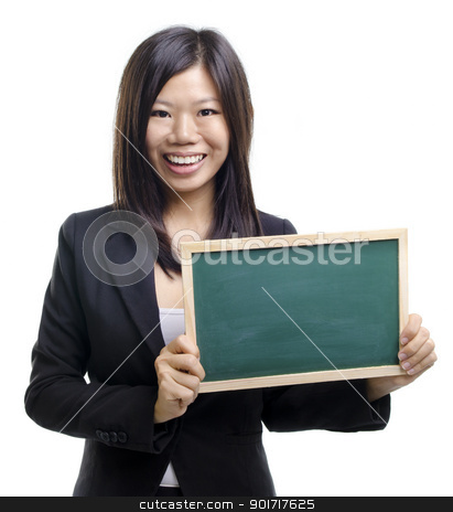 Blank blackboard stock photo, Happy smiling Asian business girl holding blank blackboard, closeup portrait on white background. by szefei