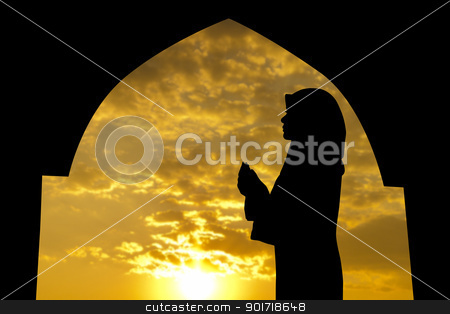Muslim praying in mosque stock photo, Silhouette of Female Muslim praying in mosque during sunset time by szefei