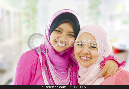 Happy Muslim women stock photo, Happy Muslim women standing inside house by szefei