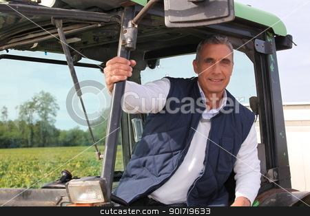 Farmer in the cab of his tractor stock photo, Farmer in the cab of his tractor by photography33