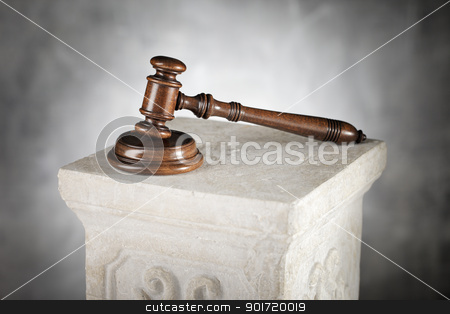 Mahogany Gavel stock photo, Mahogany gavel and sound block on a plaster column. by Stocksnapper