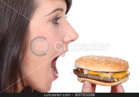 Brunette girl eating hamburger, profile-view stock photo, Brunette girl eating hamburger, profile-view by photography33
