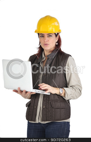 Female construction worker using her laptop stock photo, Female construction worker using her laptop by photography33