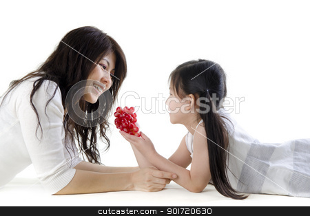 Healthy eating stock photo, Mother and daughter sharing grapes on white background by szefei