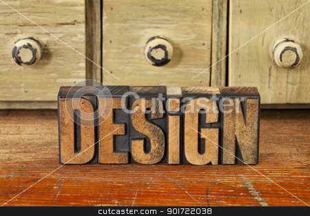 design word in vintage wood type stock photo, design word in vintage wood letterpress printing blocks with rustic drawer cabinet in background by Marek Uliasz