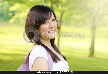 Asian student stock photo, Asian adult student standing outdoor park, green tree background by szefei