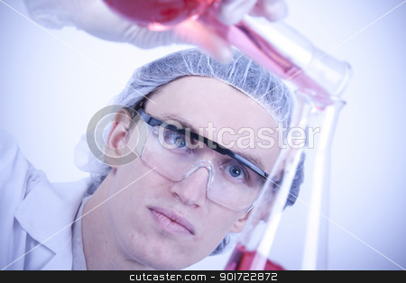 Scientist experimenting with colorfull fluids stock photo, Scientist experimenting with colorfull fluids by fikmik