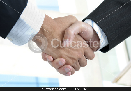 Handshake stock photo, Asian businessman handshake with modern skyscrapers as background by szefei