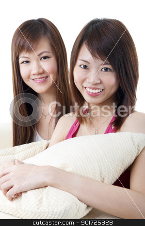 Living lifestyle stock photo, Two girls sitting on sofa, looking at camera. by szefei