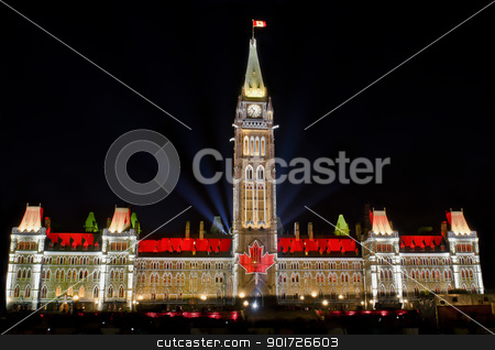 Political Vision stock photo, The Canadian Parliament Centre Block light show featuring the maple leaf flag at night. by Michel Loiselle