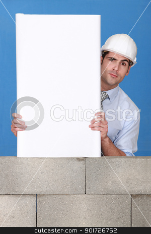 An architect presenting his blueprint. stock photo, An architect presenting his blueprint. by photography33
