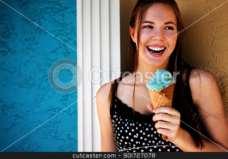 Young Woman Eating Ice Cream Outside stock photo, Happy young woman eating ice cream outside by Stephanie Zieber