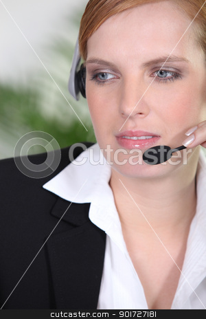 Receptionist with headphones and microphone stock photo, Receptionist with headphones and microphone by photography33