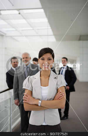 smiling businesswoman standing cross-armed in workplace stock photo, smiling businesswoman standing cross-armed in workplace by photography33
