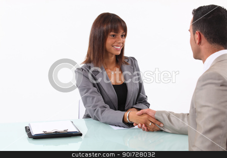 Businessman and businesswoman shaking hands stock photo, Businessman and businesswoman shaking hands by photography33