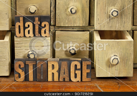 data storage concept stock photo, data storage concept - words in vintage letterpress wood type and primitive rustic wooden apothecary drawer cabinet by Marek Uliasz