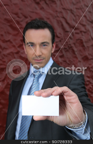 Businessman offering a blank business card stock photo, Businessman offering a blank business card by photography33