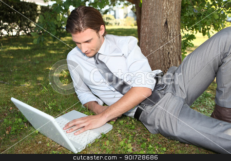 Businessman working outside on laptop stock photo, Businessman working outside on laptop by photography33