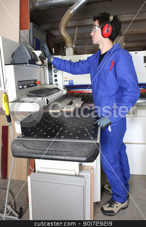 young man working in a factory stock photo, young man working in a factory by photography33