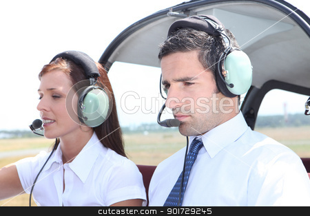 Man and woman in a light aircraft stock photo, Man and woman in a light aircraft by photography33