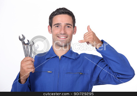 Mechanic making telephone with hand stock photo, Mechanic making telephone with hand by photography33