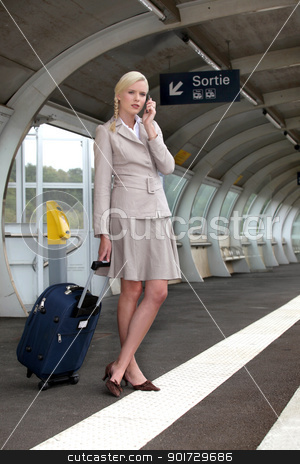 portrait of a businesswoman at train station stock photo, portrait of a businesswoman at train station by photography33