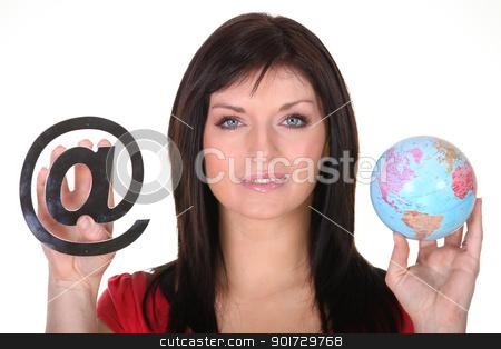 Woman holding globe and at symbol stock photo, Woman holding globe and at symbol by photography33