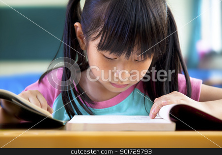 little girl studying in classroom at school stock photo, little girl studying in classroom at school by tomwang