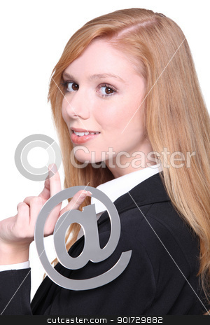 Woman dangling the at symbol over her shoulder stock photo, Woman dangling the at symbol over her shoulder by photography33