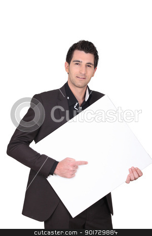 Man pointing to a blank sign stock photo, Man pointing to a blank sign by photography33