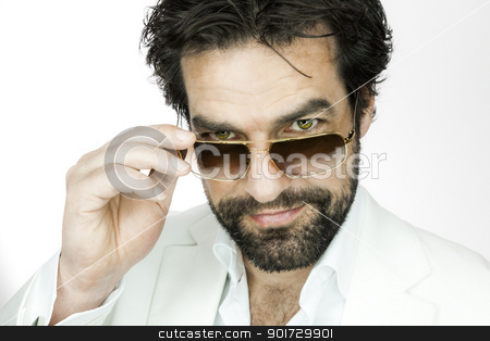 man with beard stock photo, A handsome man with a beard and sun glasses by Markus Gann