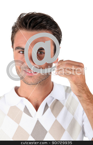 Man holding metallic at symbol over eye stock photo, Man holding metallic at symbol over eye by photography33
