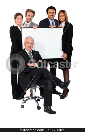 Four young executives holding a blank presentation board behind their boss stock photo, Four young executives holding a blank presentation board behind their boss by photography33