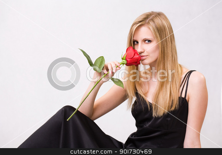 Gorgeous young blond woman holding rose. stock photo, Romantic portrait of a gorgeous young blond woman holding big red rose. by exvivo
