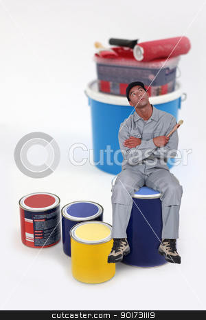 Photomontage of a man sat on a blue paint can stock photo, Photomontage of a man sat on a blue paint can by photography33
